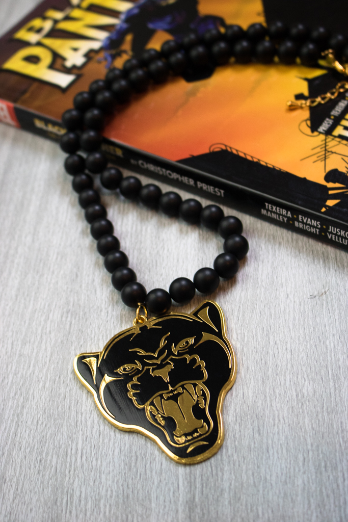 gold panther b pendant necklace